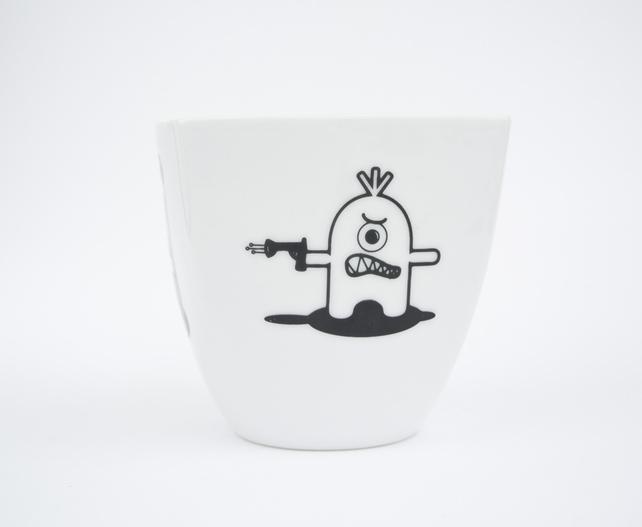 Coffee mug with cute monsters